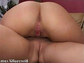 Two brunettes having sex on the couch