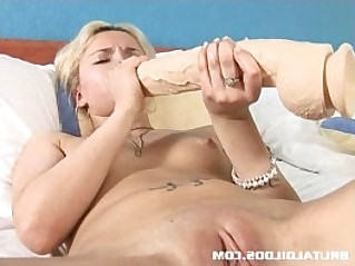 Blonde Russian fills her tight pussy with a big brutal dildo